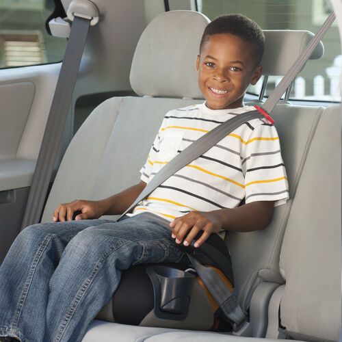 boy riding in chicco kidfit 2 in 1 belt positioning booster car seat with